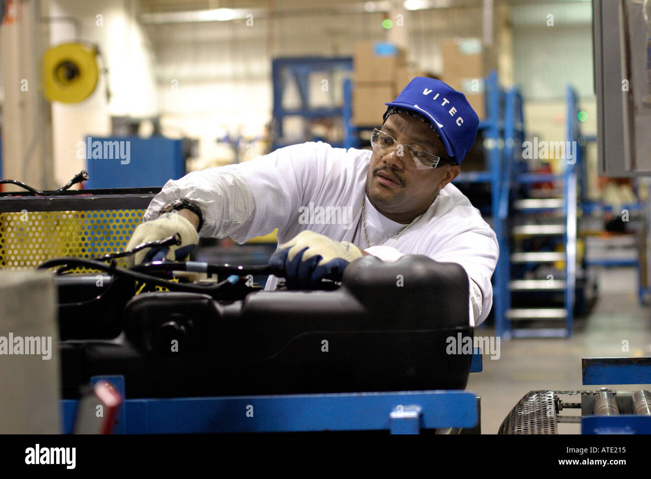Workers at Vitec manufacture automobile gas tanks for General Motors - Stock Image