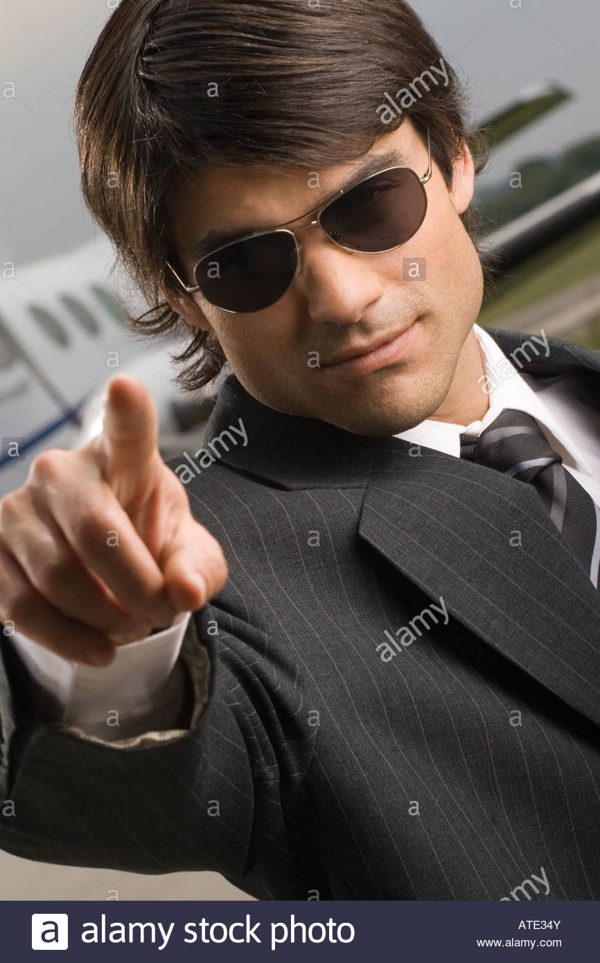 Close-up of a businessman pointing - Stock Image