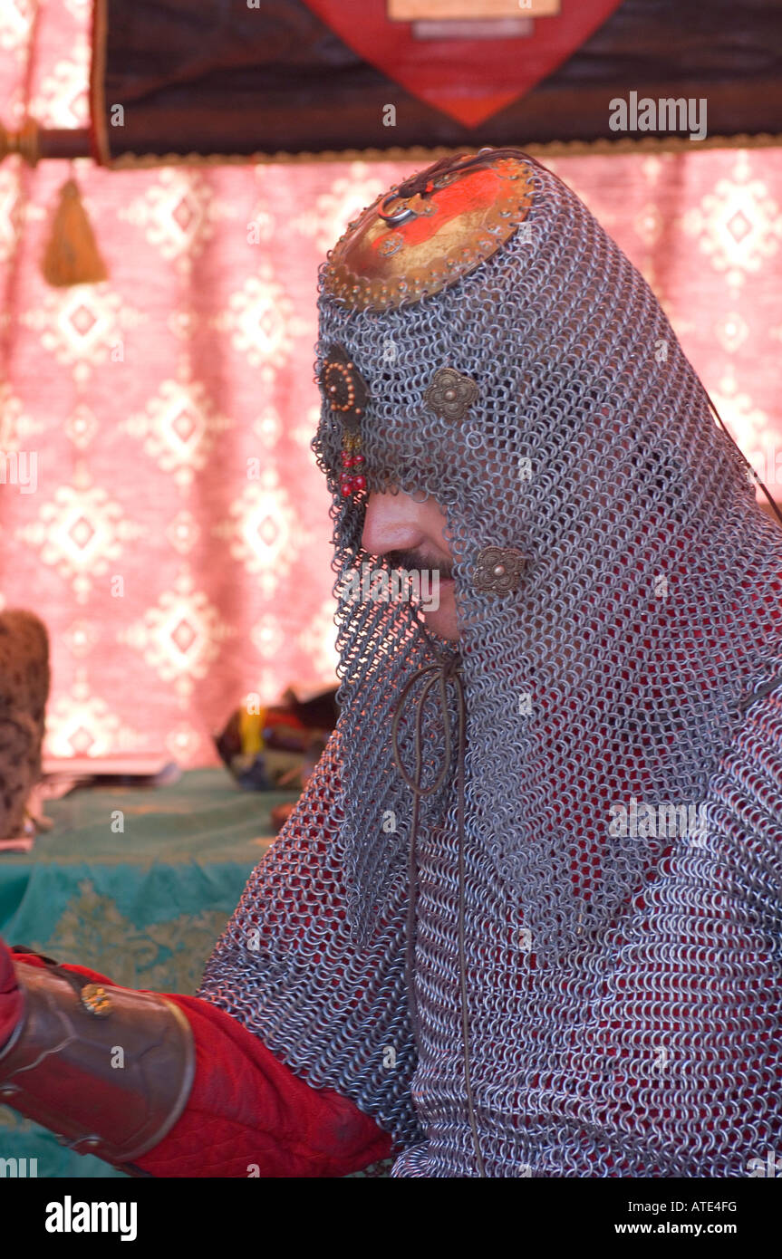 Man wearing traditional European chain mail. - Stock Image