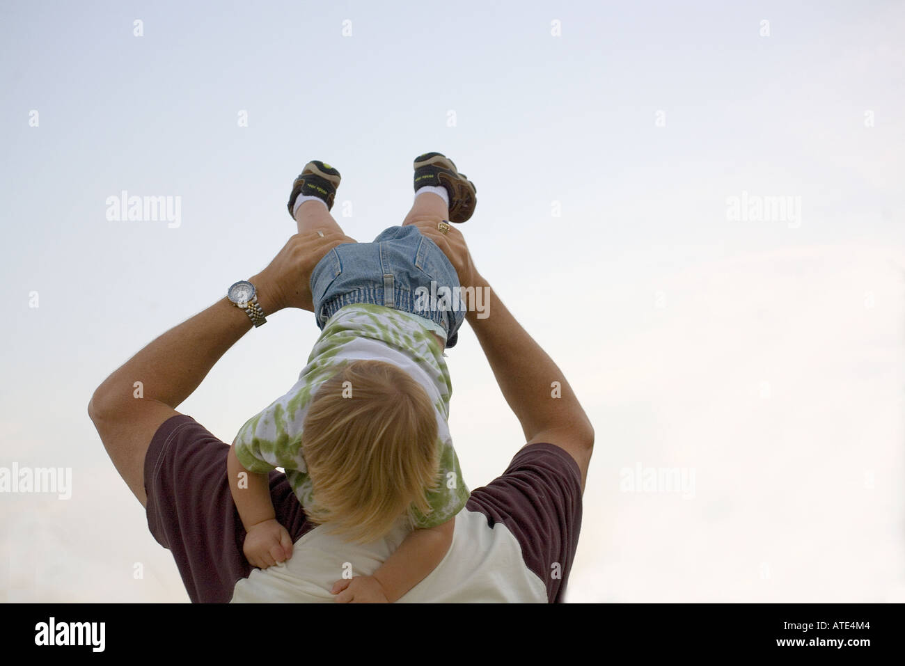 Young boy playing with his father - Stock Image