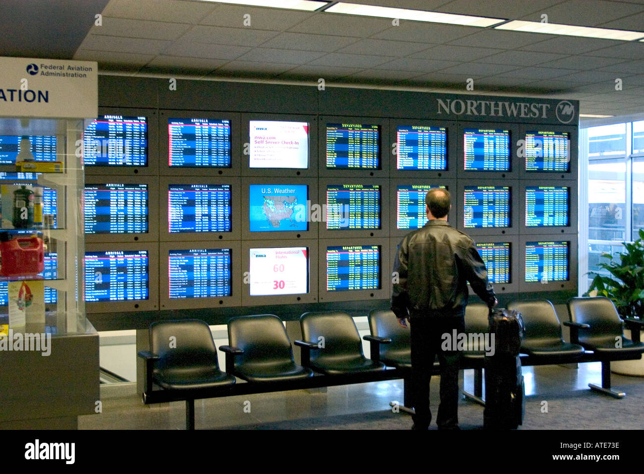 Bank of passenger departure and arrival screens at the Minneapolis-St. Paul International Airport. Minneapolis Minnesota MN USA - Stock Image