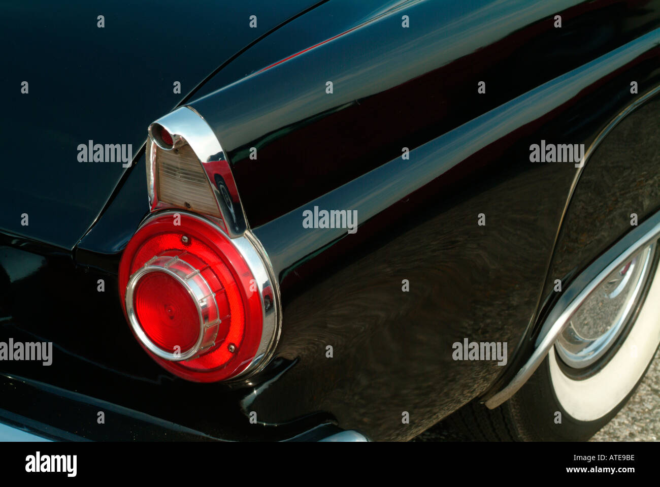 detail of an antique car fender and tail light - Stock Image