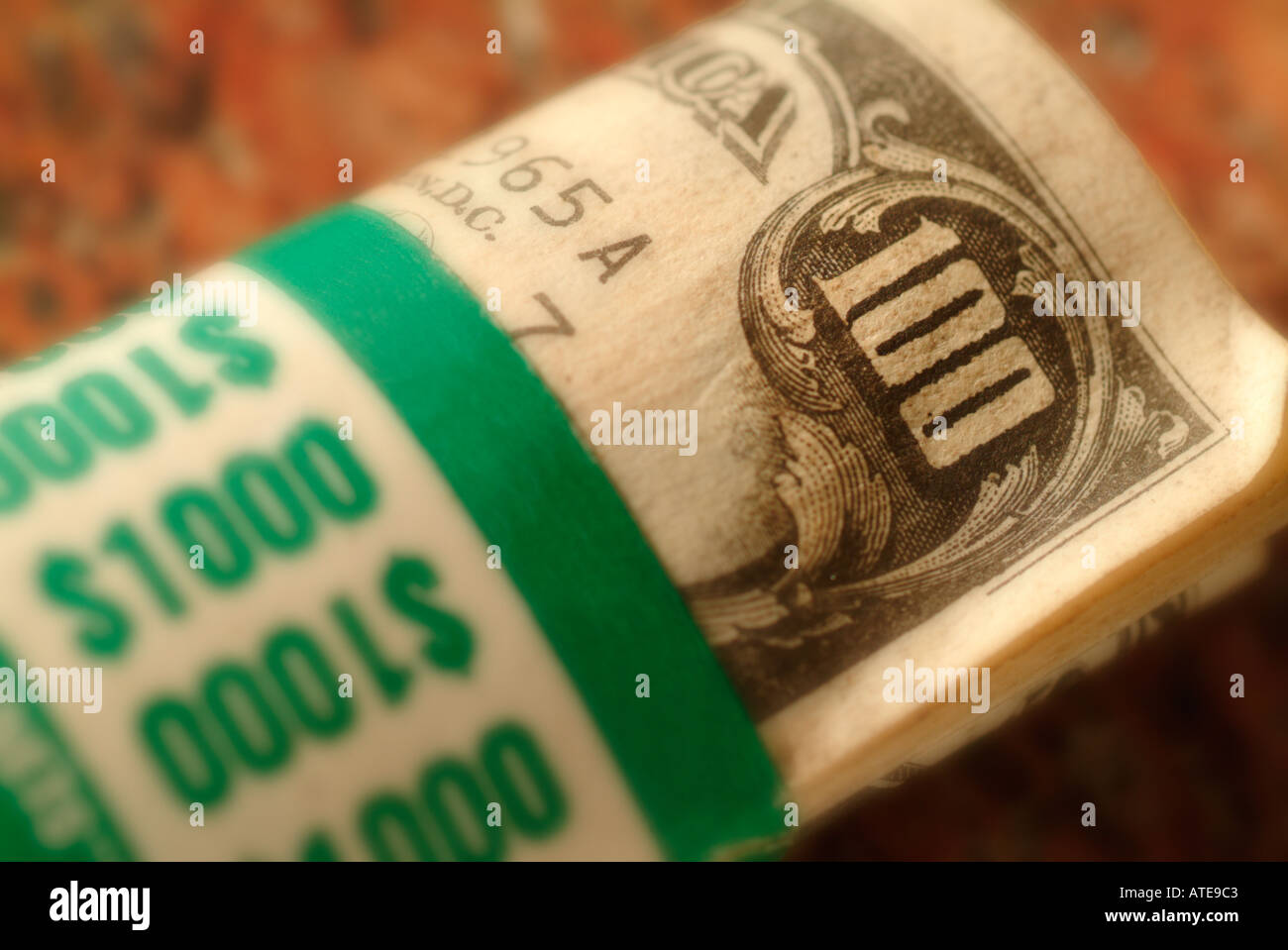 a roll of ten One Hundred dollar bills totaling US $1000 - Stock Image