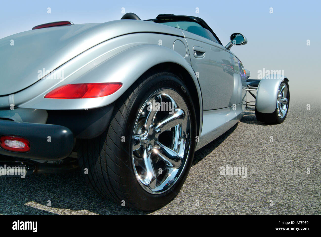 A modern hot rod. A silver Chrysler Prowler as seen from the rear ...
