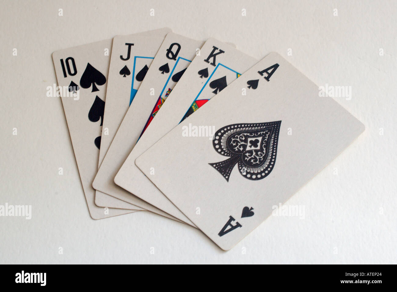 Royal flush ten jack queen king and ace of spades Stock