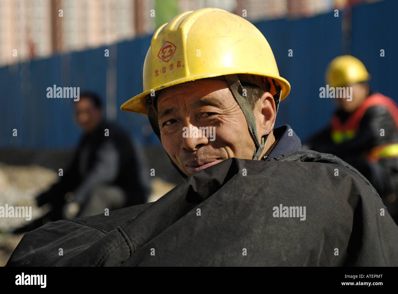 Chinese workers at construction site of National Stadium for the Beijing 2008 Olympic Games. 27-Feb-2008 - Stock Image