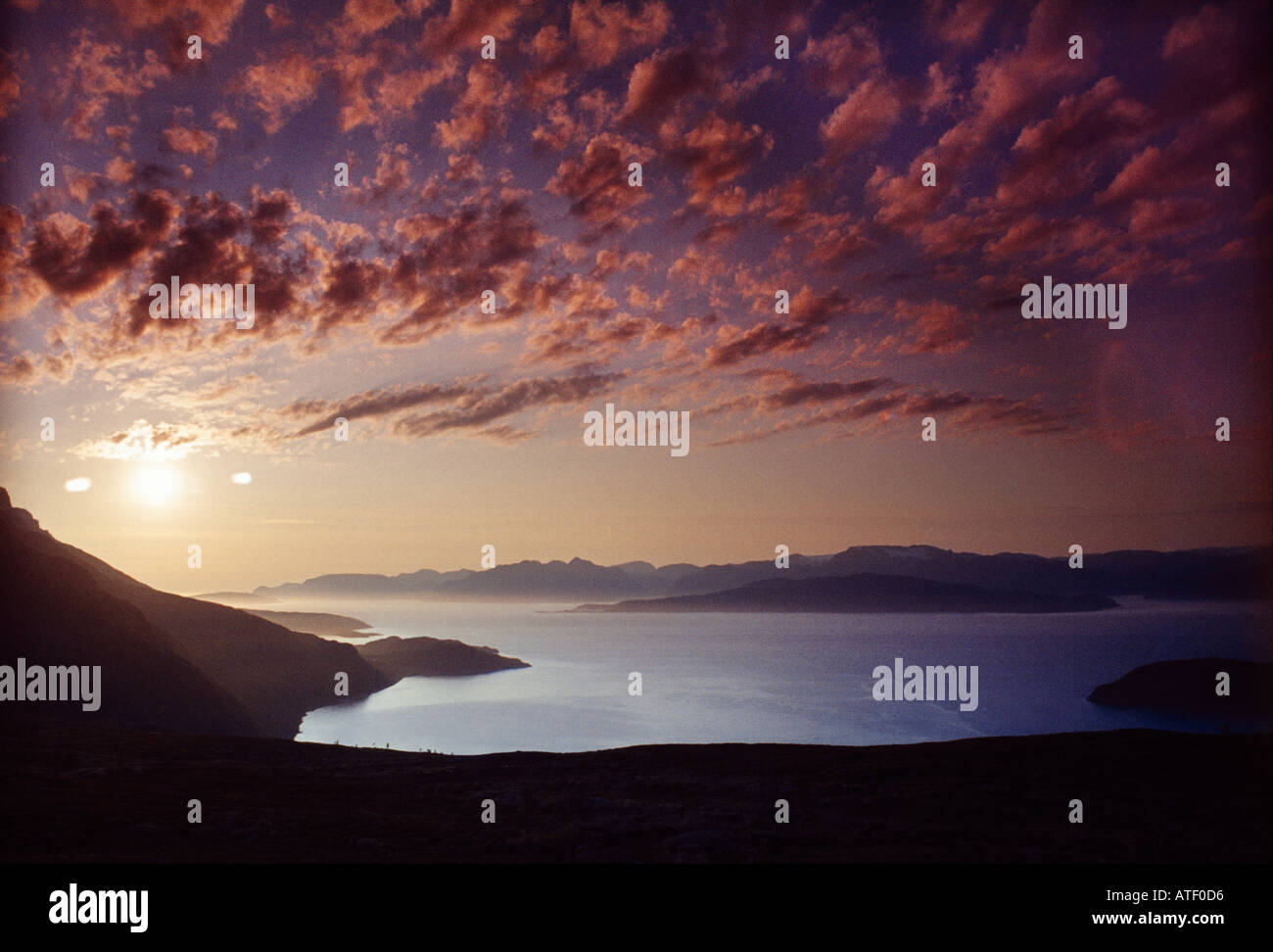 Midnight sun at 1am over Reisafjord northern Norway - Stock Image