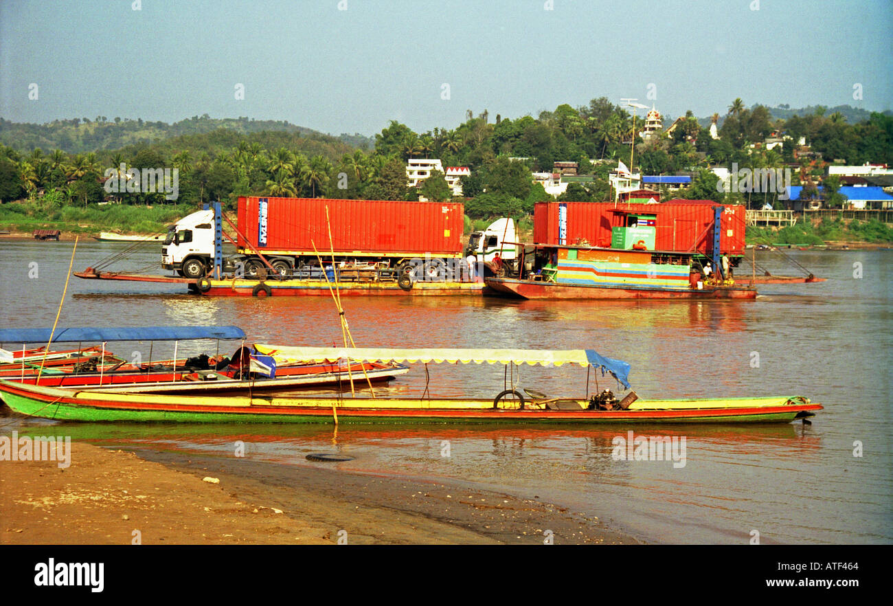Colourful lorry crossing traditional beauty exotic tropical man tree vegetation Mekong River Huay Xai Laos Southeast Asia - Stock Image