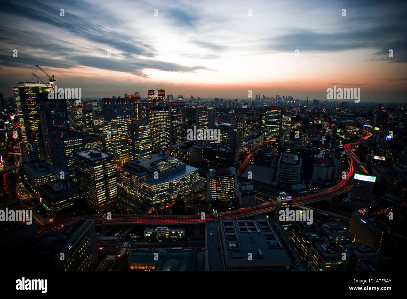 Night time cityscape of Tokyo Central Station area - Stock Image