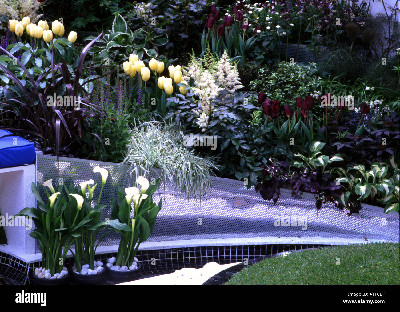 Tulips and Arum lily in the Football coming haome garden Chelsea Flower Show 2004 - Stock Image