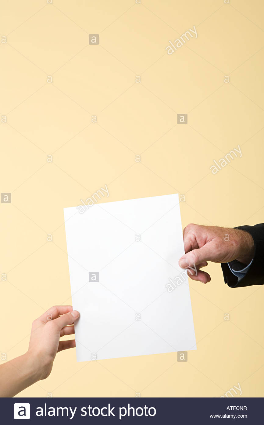 Two people holding a paper - Stock Image