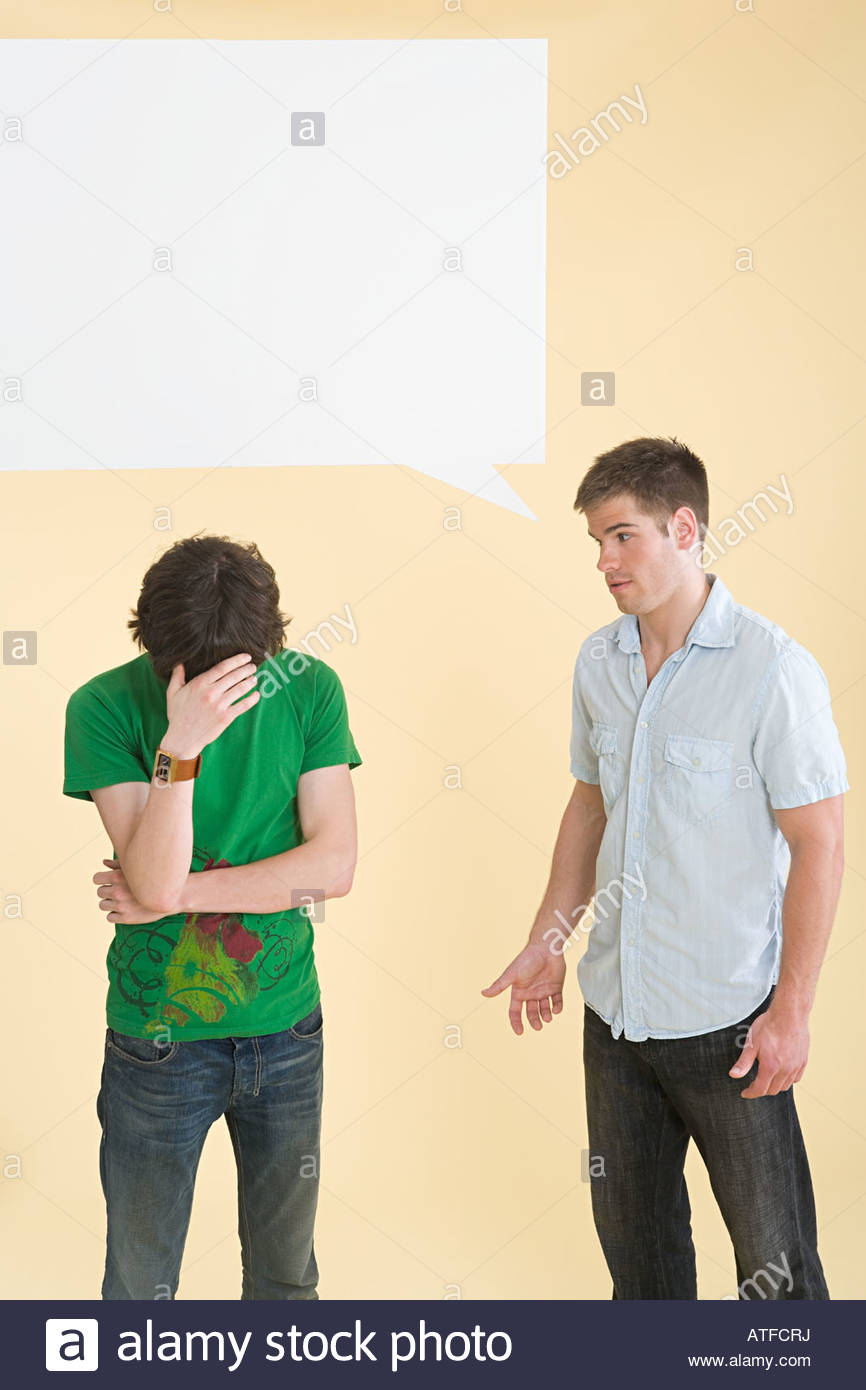 A man talking to another man crying - Stock Image
