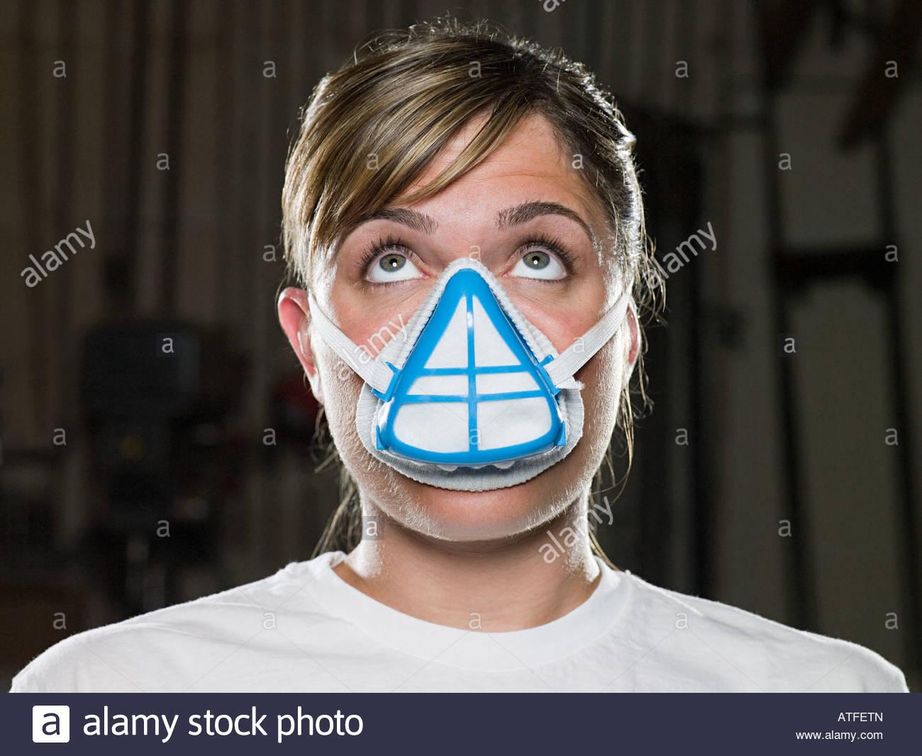 Woman wearing a dust mask Stock Photo: 16302788 - Alamy