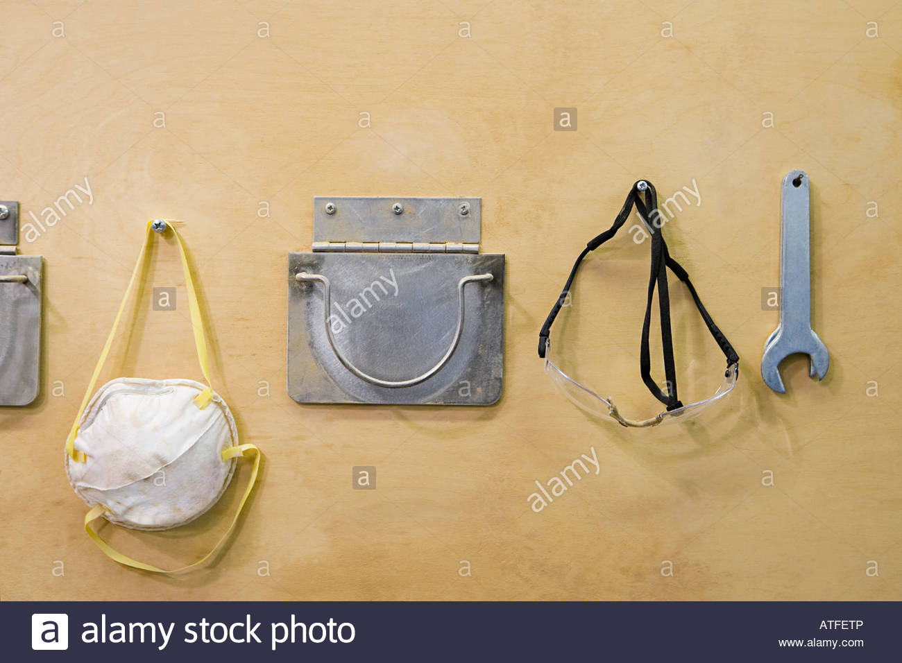 Saftey wear on a wall - Stock Image