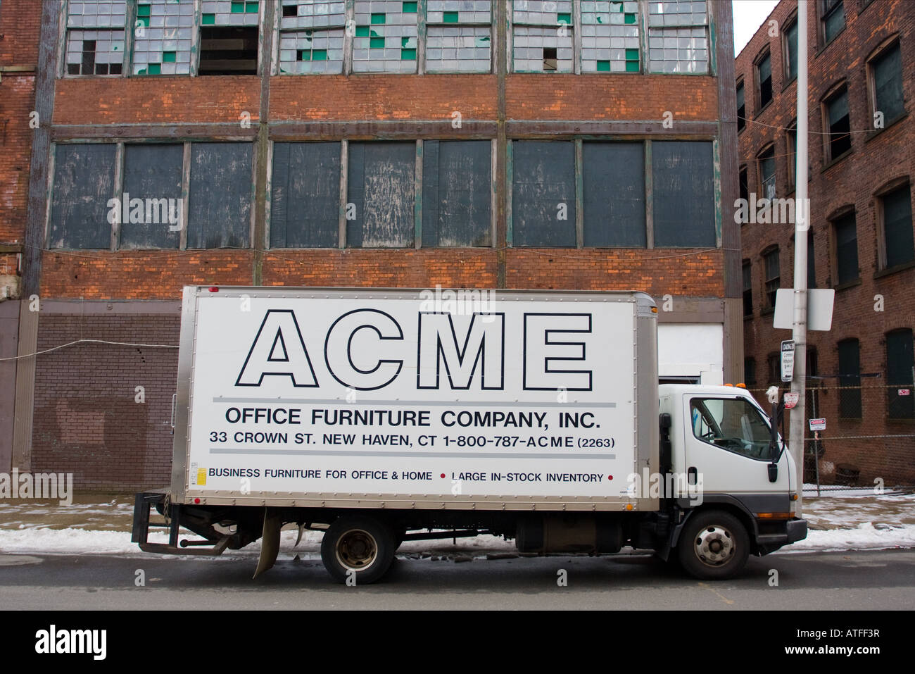 An ACME Furniture Truck In Front Of A Blighted Building In New Haven  Connecticut USA. ACME Is A Common Name In The USA.