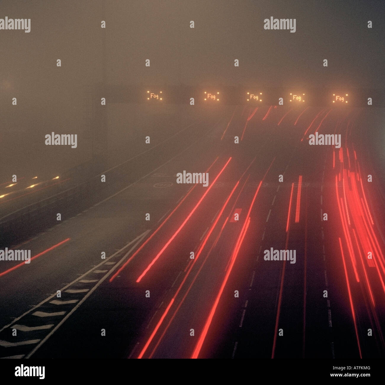 Thick fog on the M25 motorway approaching the Dartford crossing London Kent England UK. - Stock Image