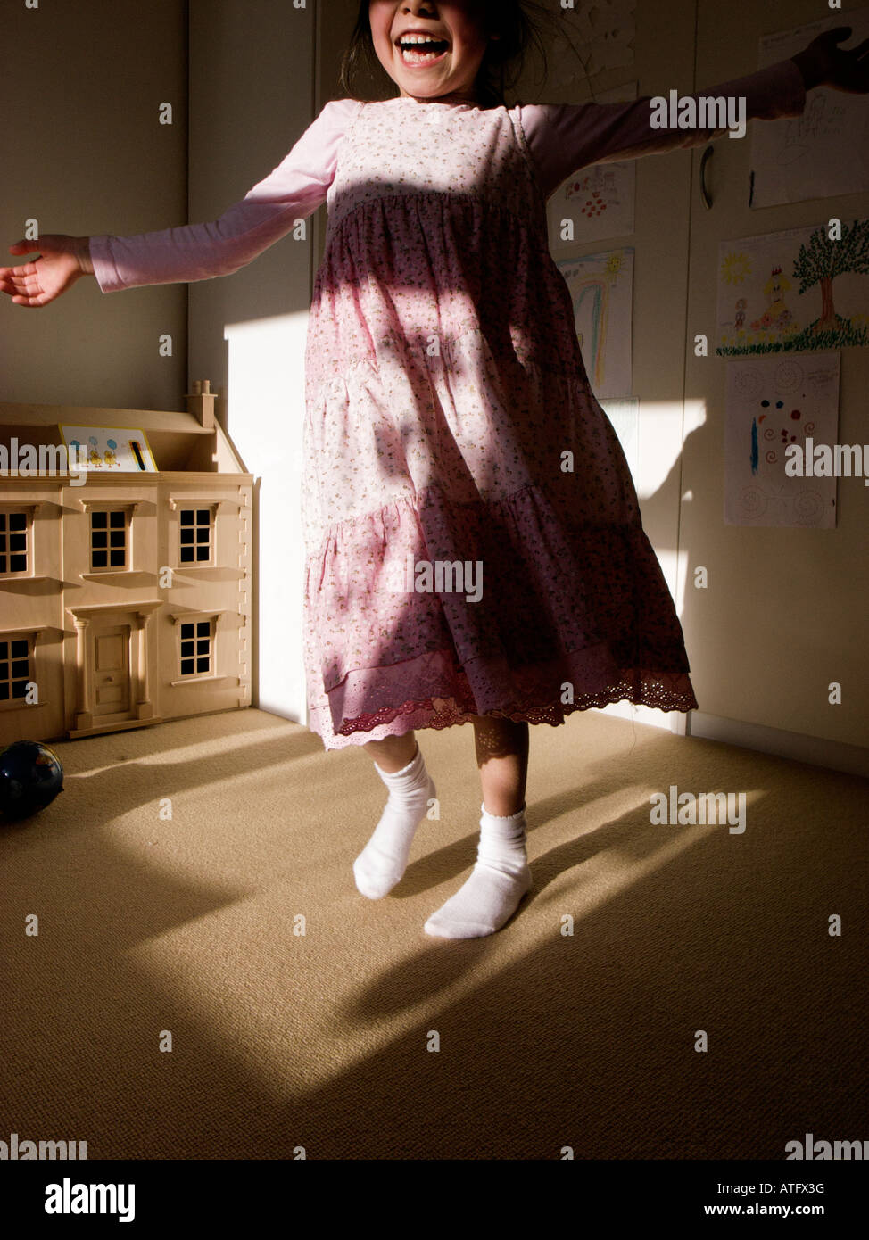 Child dancing at home - Stock Image