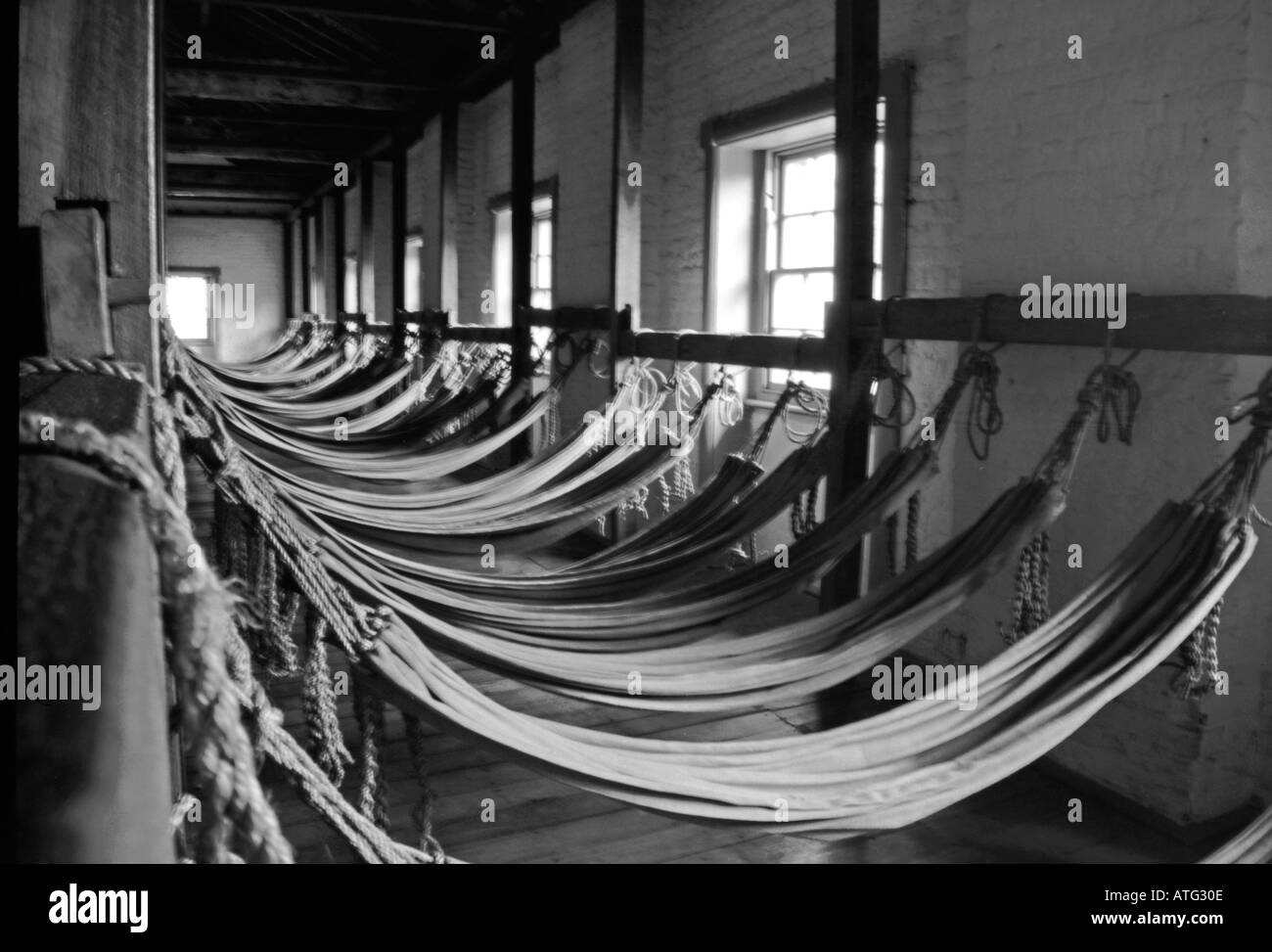 Row of hammocks in old prison, Melbourne, Australia - Stock Image