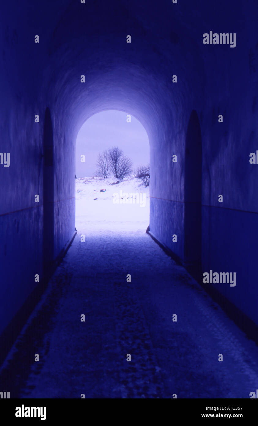 Passage with winter landscape at the end. Light at the end of the tunnel. Is there anybody out there? - Stock Image