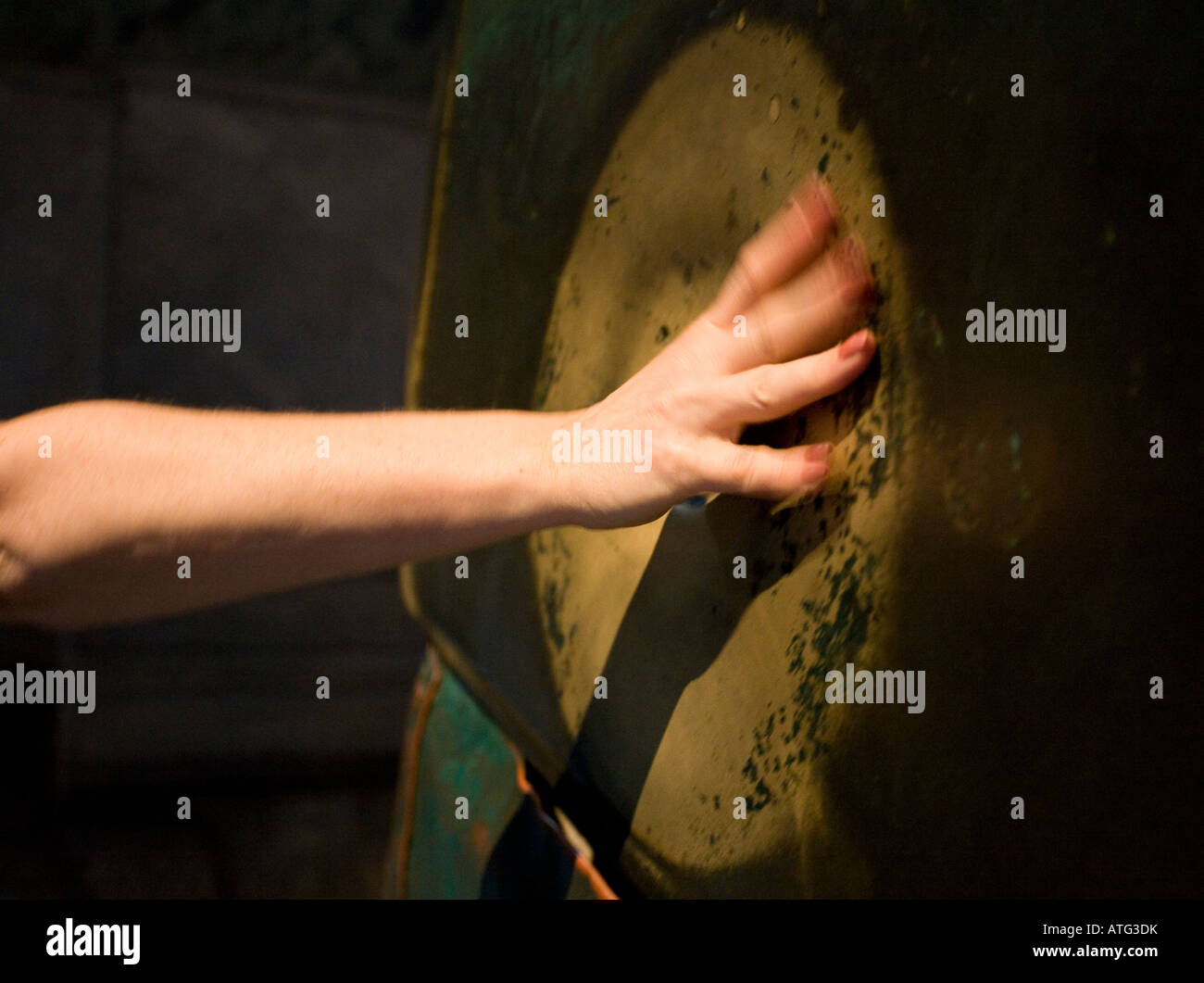 Miracle Column of Saint Gregory. A hand makes the traditional circle in the legendary pillar that weeps holy water - Stock Image