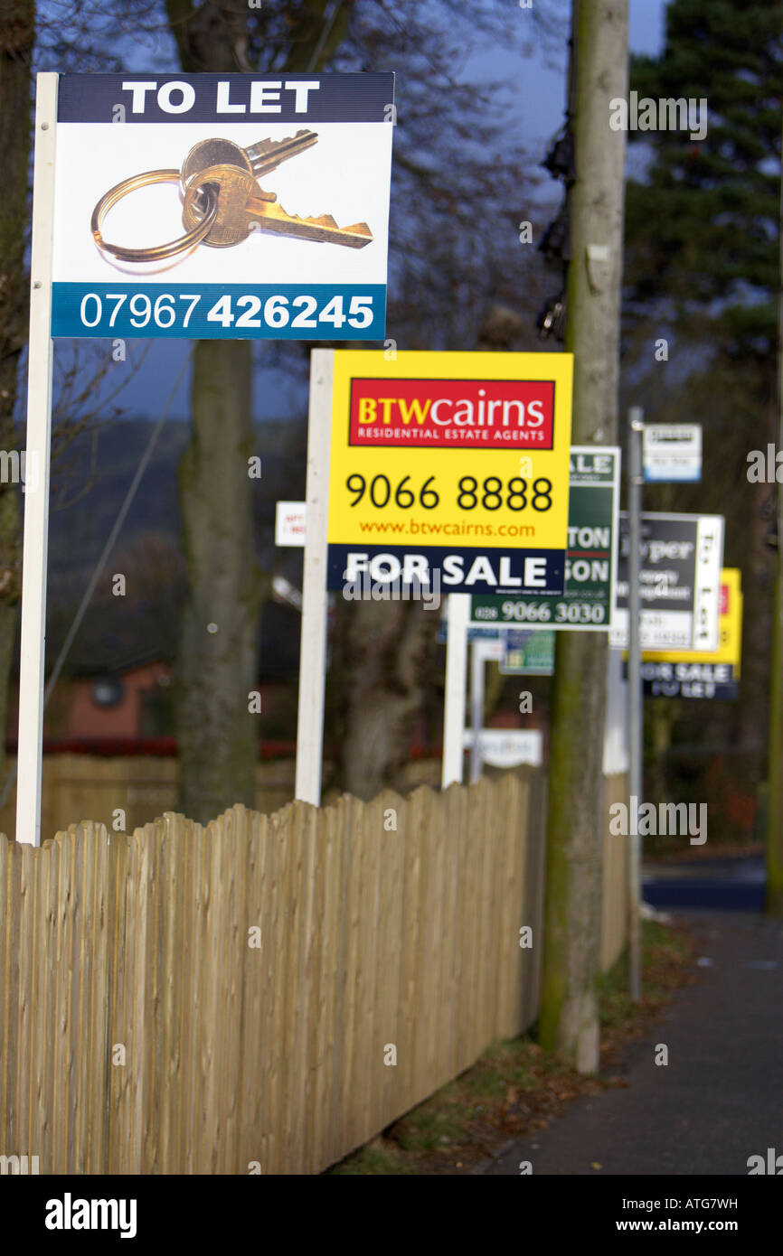estate agents for sale to let signs in a row Stock Photo