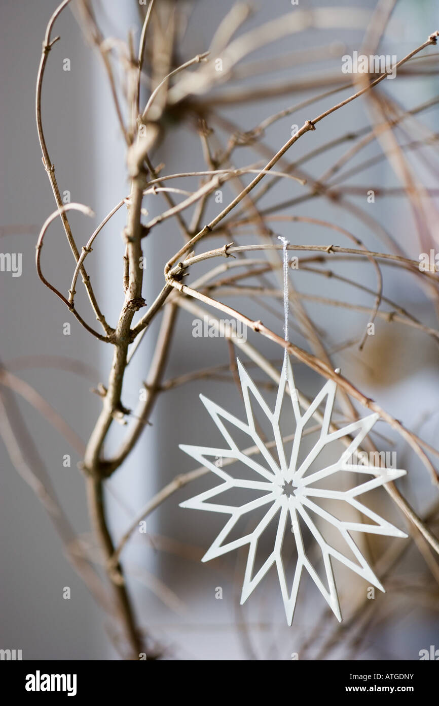 Christmas decoration on a bare tree - Stock Image