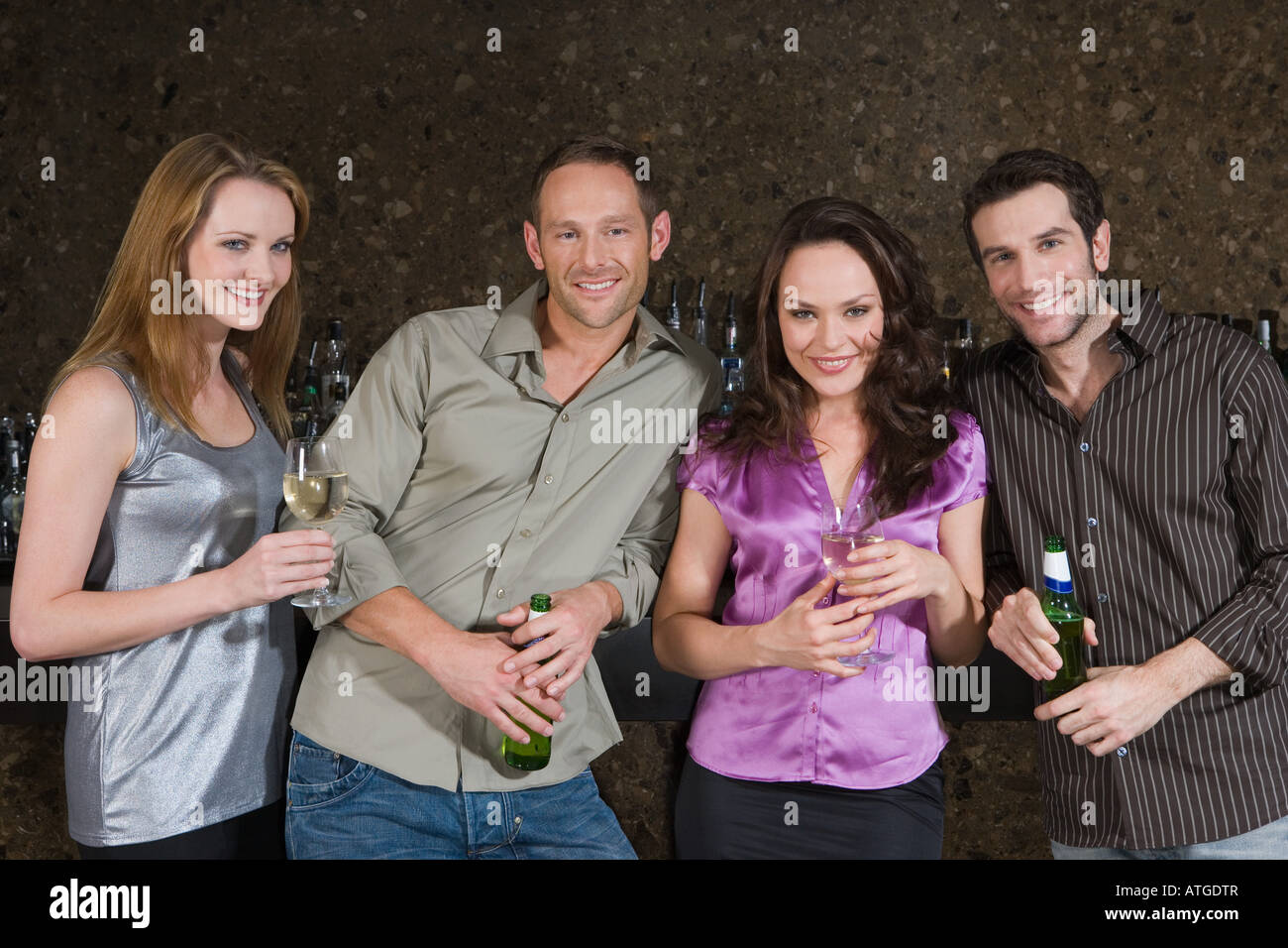 Friends drinking in a bar Stock Photo