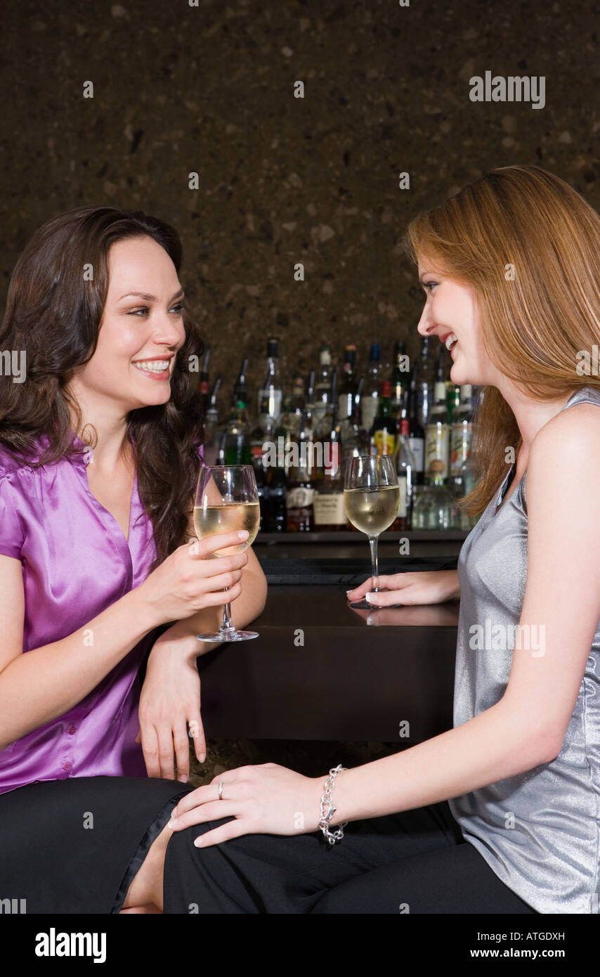 Two women drinking in a bar Stock Photo
