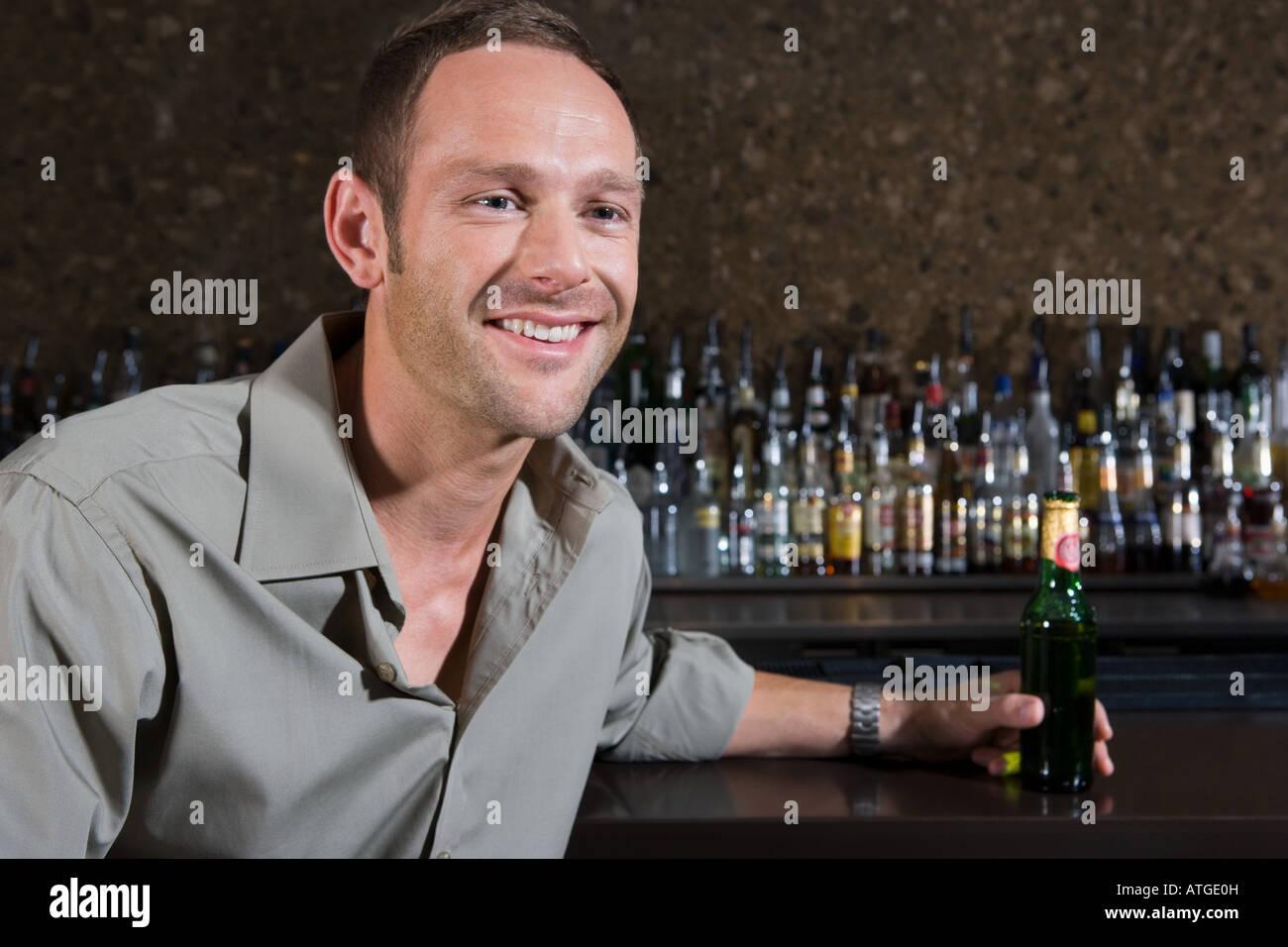Man sitting in a bar Stock Photo