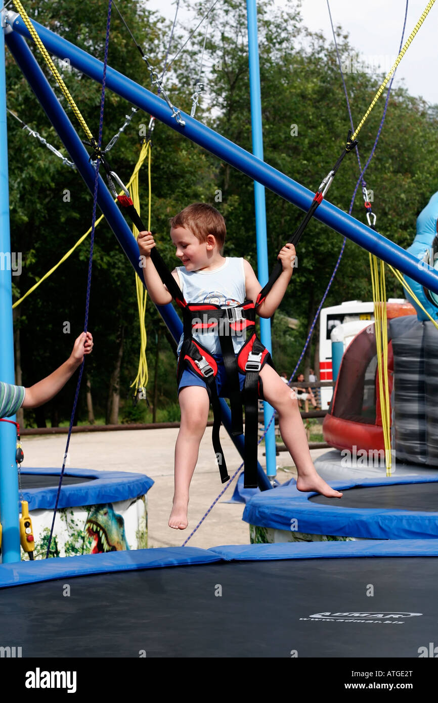 Swing Harness Auto Electrical Wiring Diagram Model Icp Ge100f141 Young Boy On Bungee Bounce Swings At Safety And