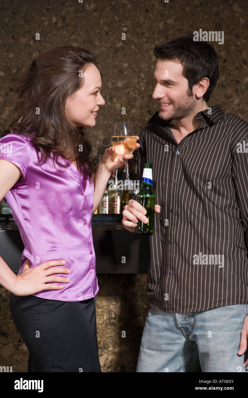 Couple flirting in a bar Stock Photo