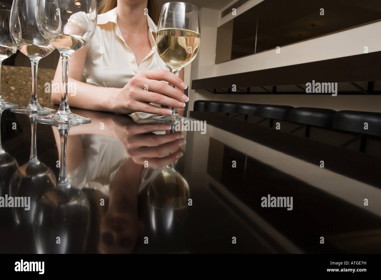 Woman drinking wine in a bar Stock Photo