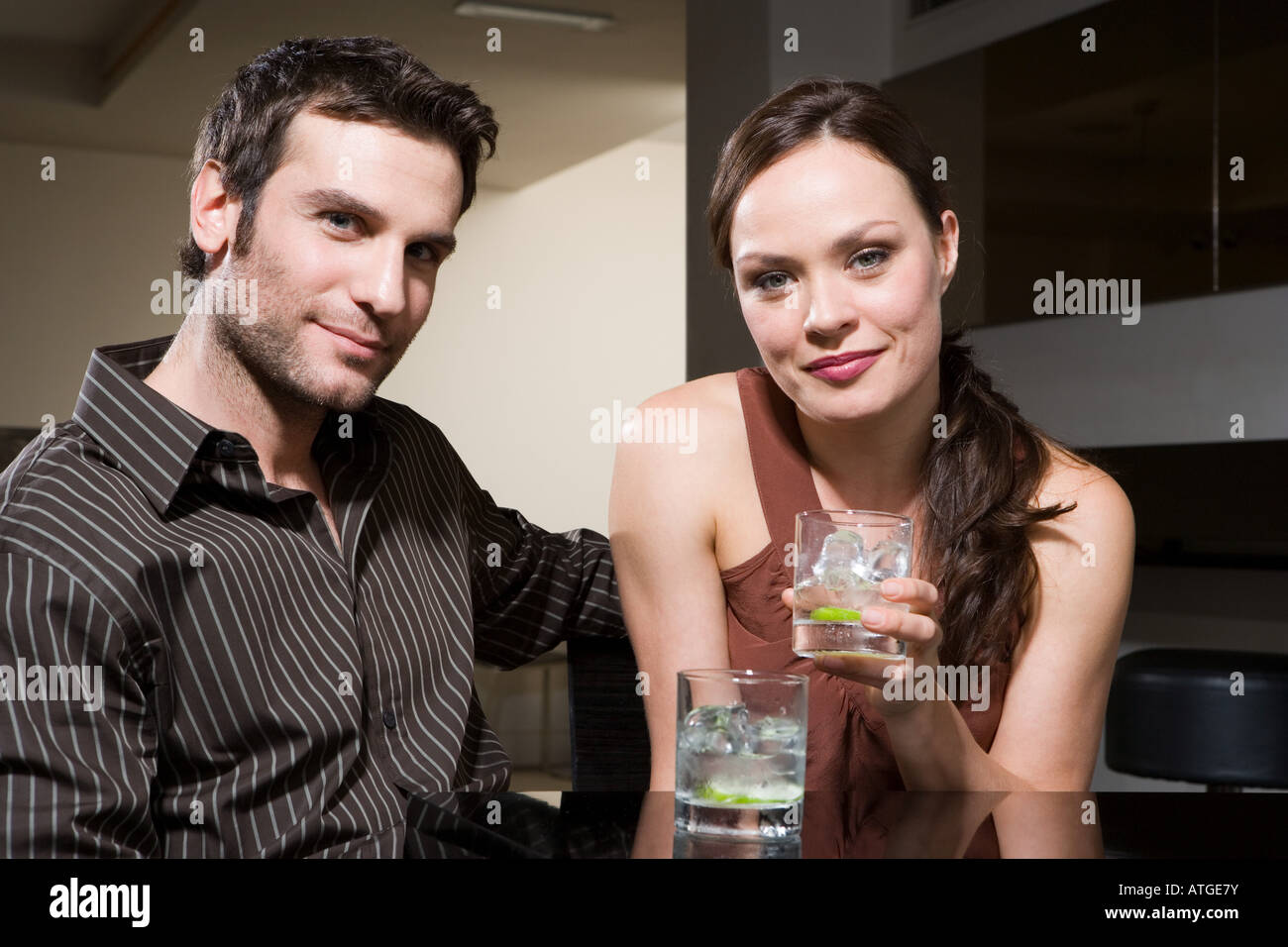 Couple drinking in a bar Stock Photo
