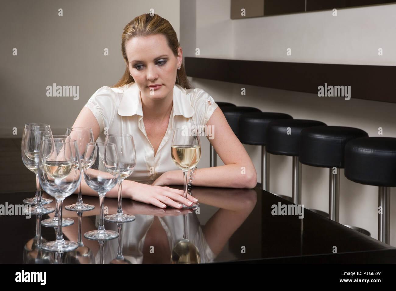 Drunken woman in a bar Stock Photo
