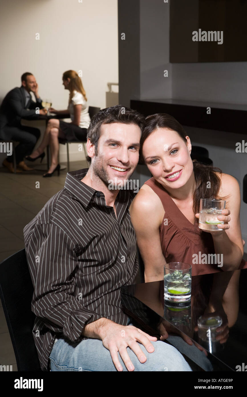 Couples dating in a bar Stock Photo