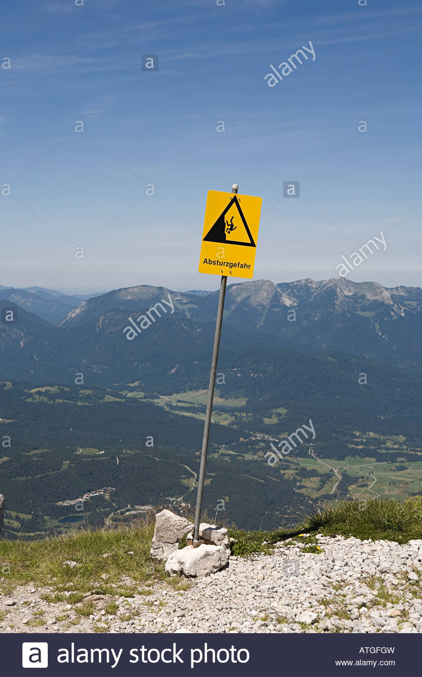 A warning sign on top of a mountain - Stock Image