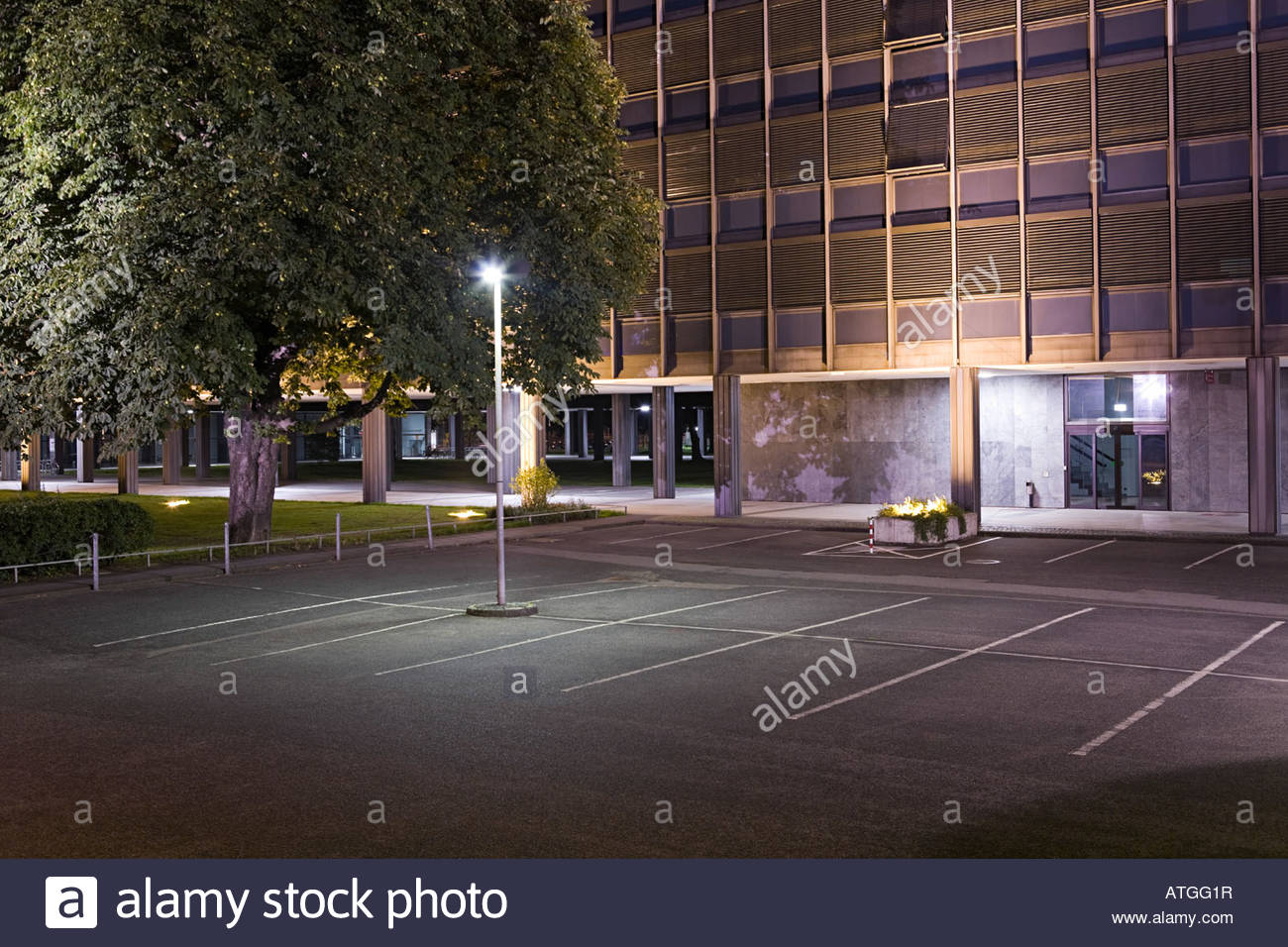 A car park infront of a building - Stock Image