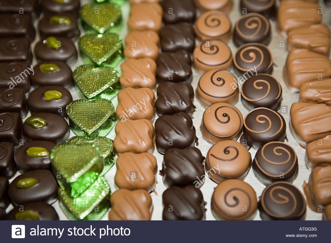 Chocolates in a row - Stock Image