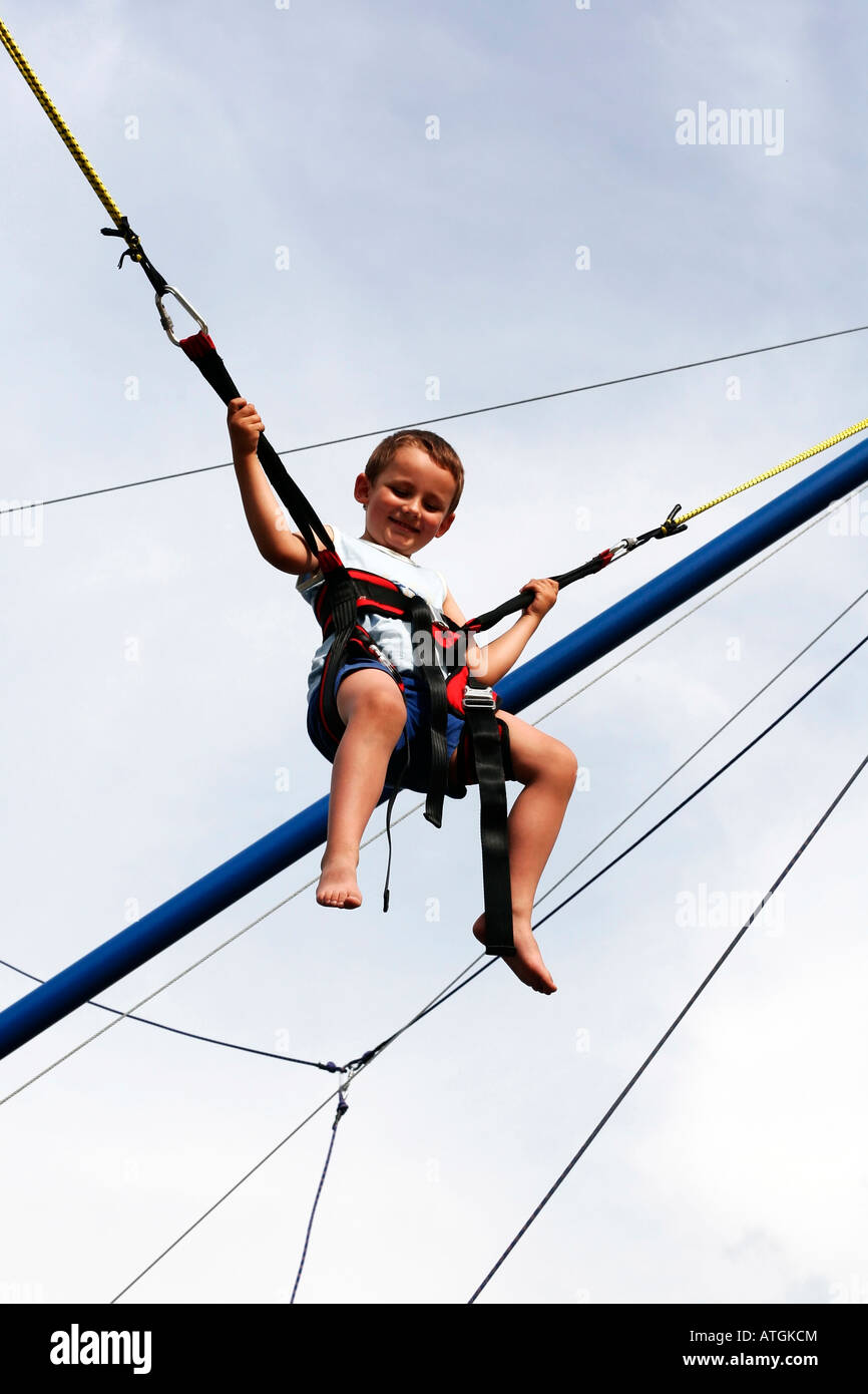 young boy in harness low angle view young boy on bungee bounce swings ATGKCM young boy in harness, low angle view, young boy on bungee bounce