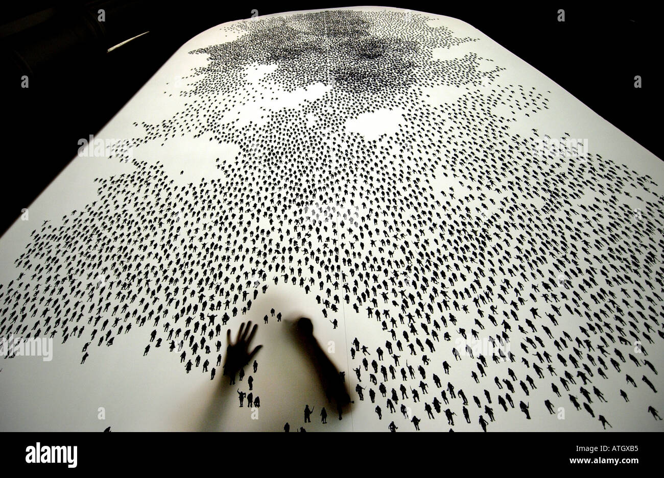 Artist painstakingly draws ten thousand tiny human figures on a screen - Stock Image