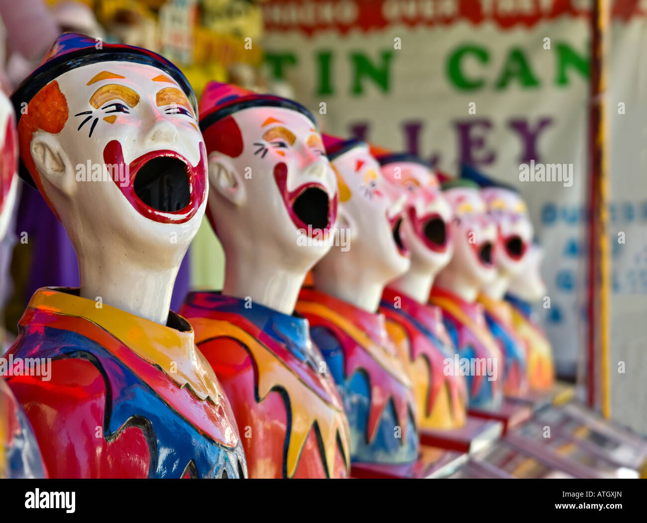 lots of clowns in a row at the fete - Stock Image