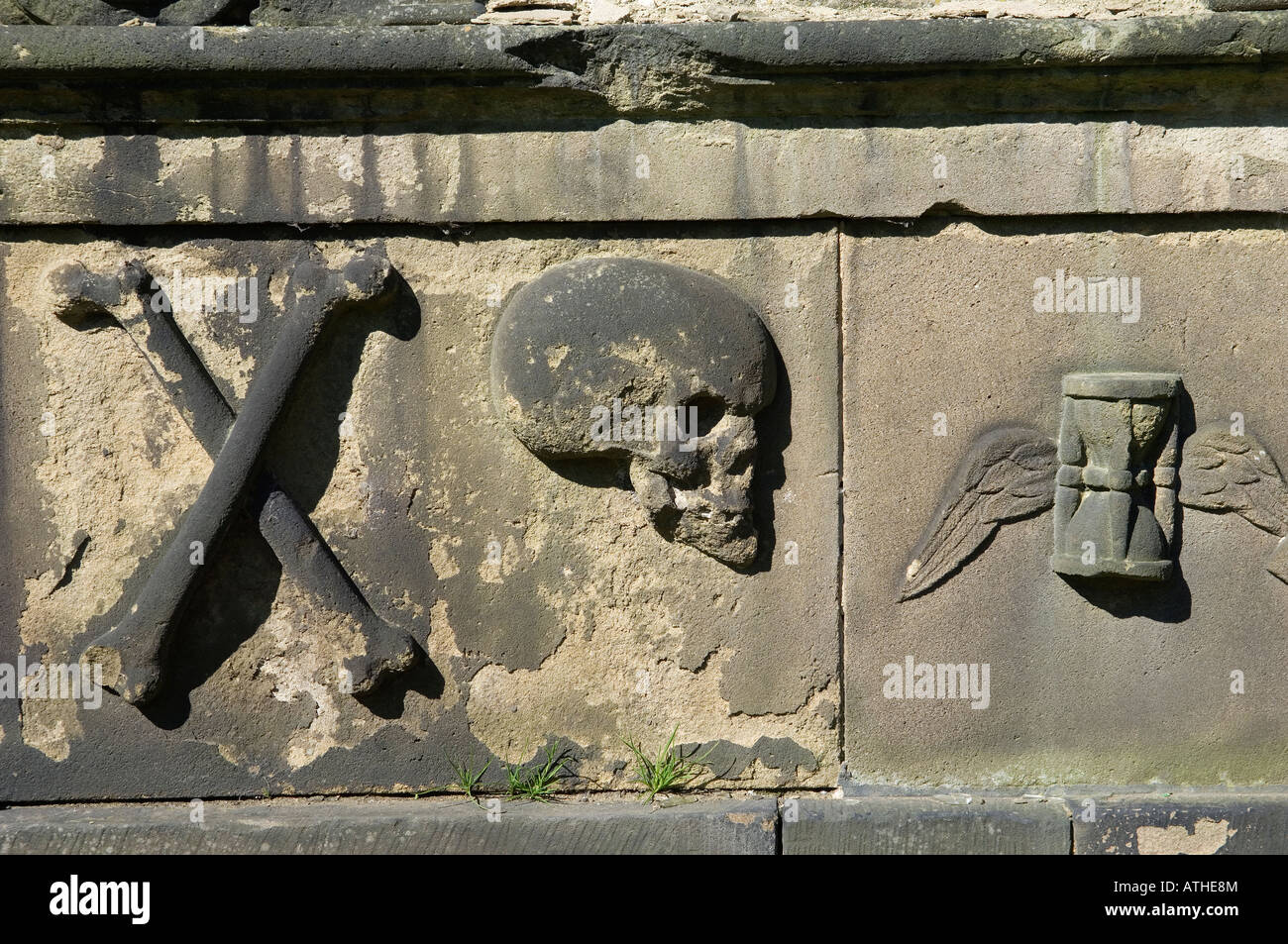 Old Calton cemetery, Calton Hill, Edinburgh, Scotland dates from 1718. Tomb grave stone detail. Skull, crossbones, - Stock Image