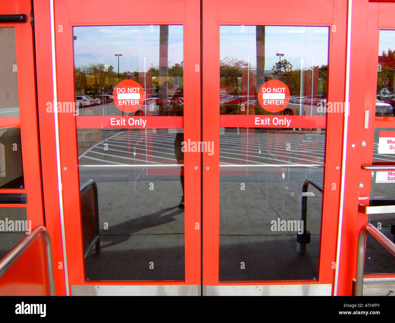 Exit only do not enter sign on glass doors in a public store & Exit only do not enter sign on glass doors in a public store Stock ...