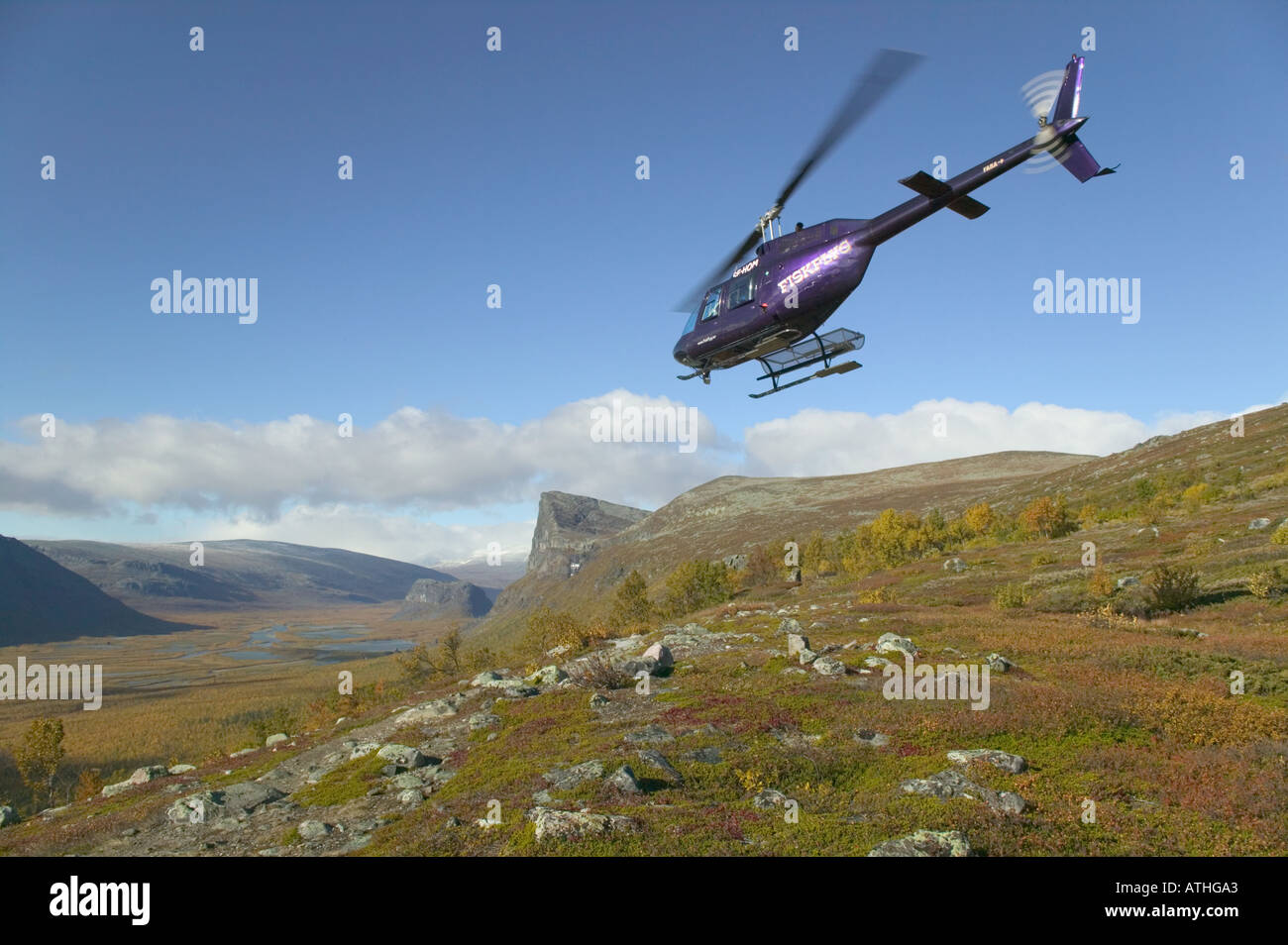 A helicopter on the edge of the Rapa Valley; Mt Sarek National Park, Laponia World Heritage Area, Lapland, Sweden. Stock Photo