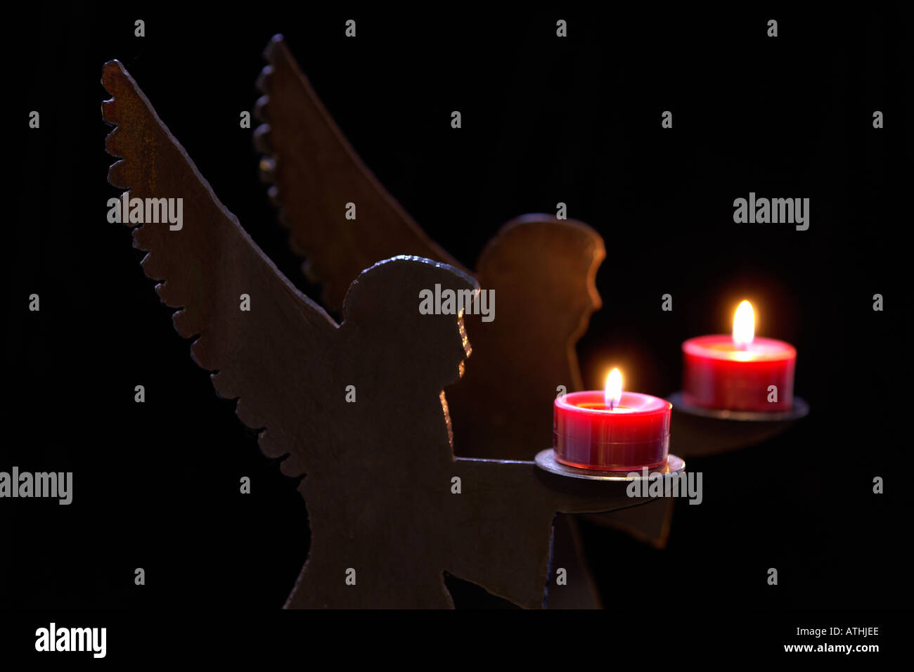 angel candle holders - Stock Image