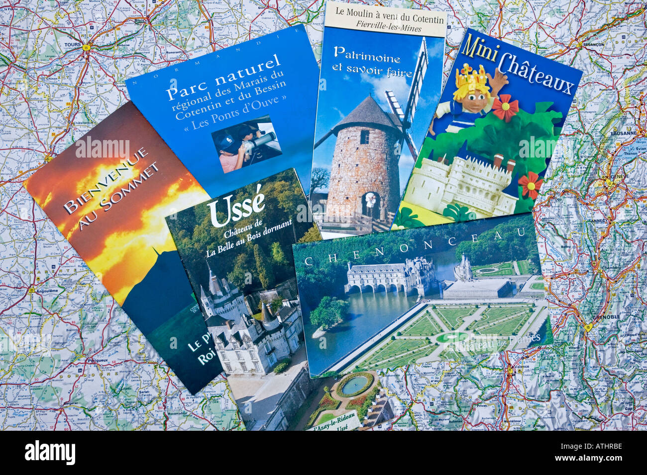 French Tourist Brochures Of Castles Scattered On Map Of France Stock
