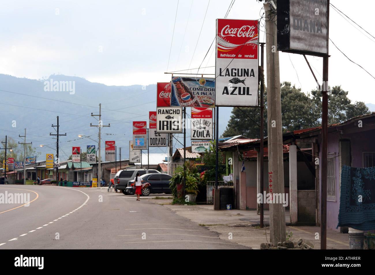 Dozens of small seafood restaurants line the highway on the eastern shore of Lago de Yojoa, Honduras. Stock Photo