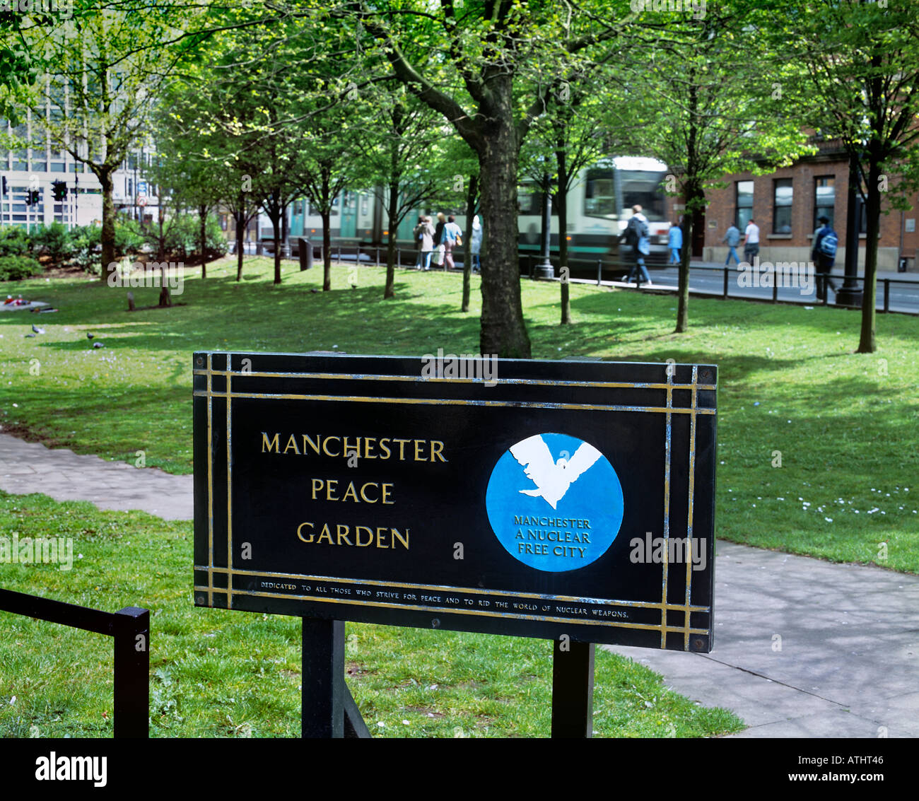 The Nuclear Free Local Authority logo on a sign in Manchester Peace Garden, St Peters Square, Manchester. - Stock Image