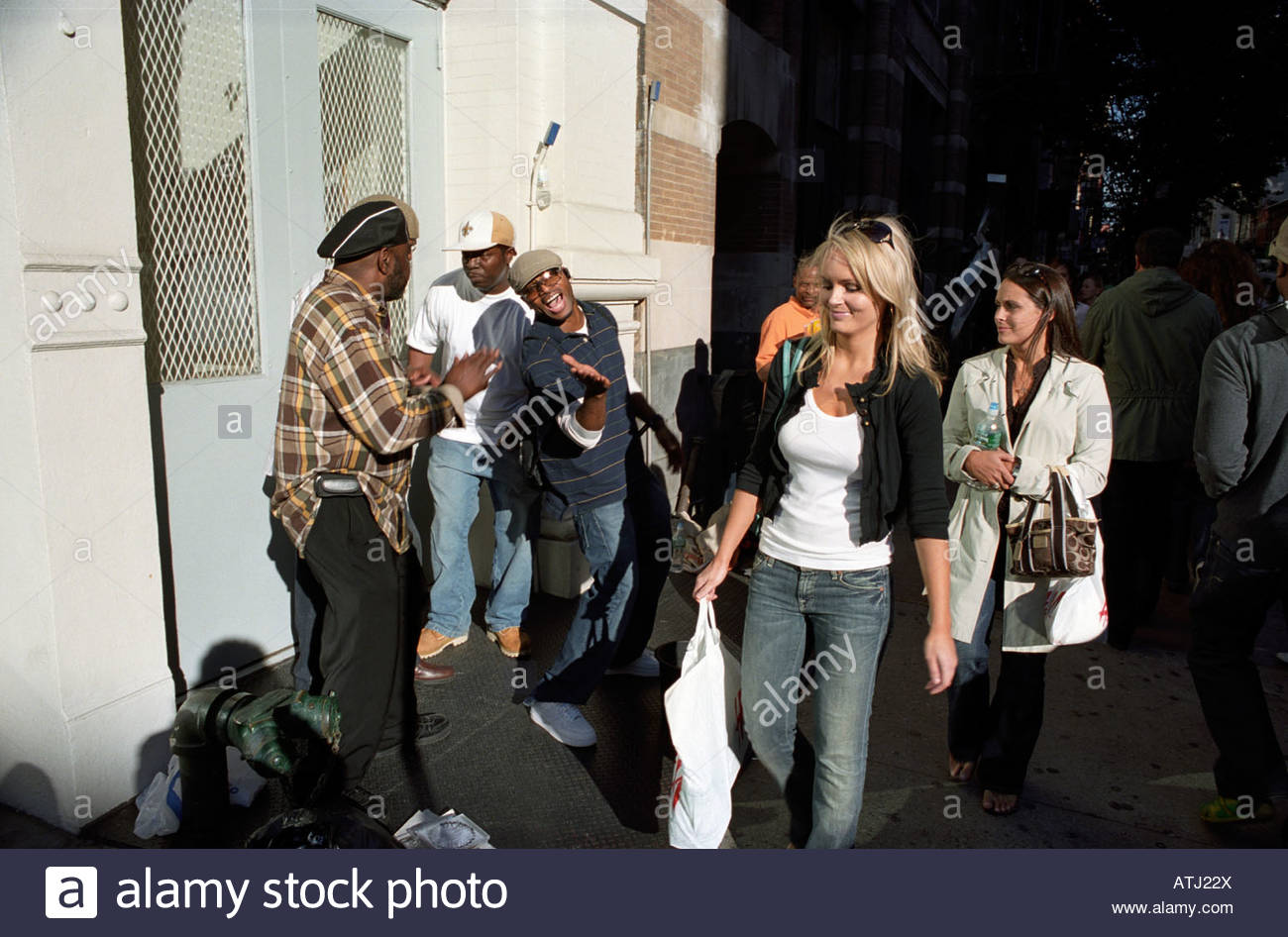 Street Singers with passers by in SoHO in Manhattan New York streets - Stock Image