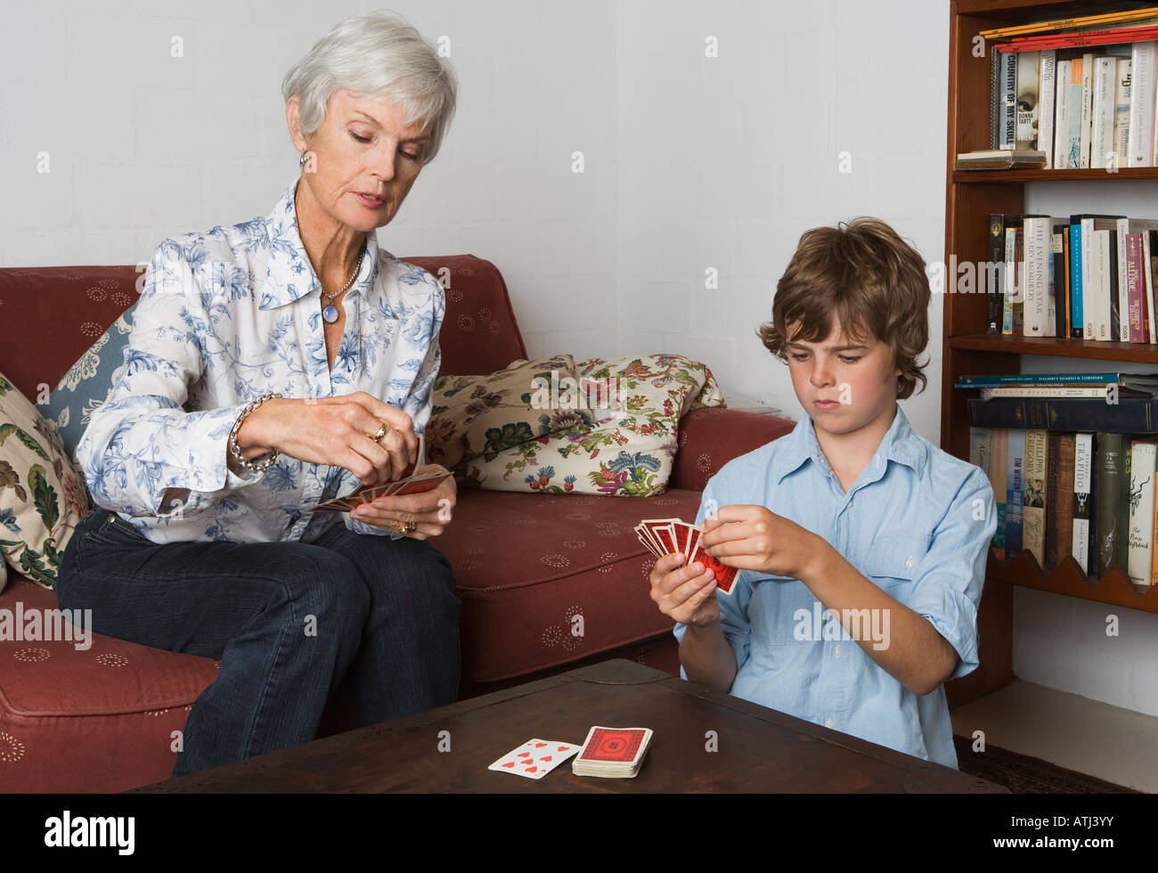 grandmother playing cards with grandson Stock Photo
